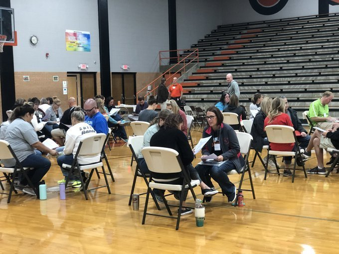 Participants in poverty simulation in a gym